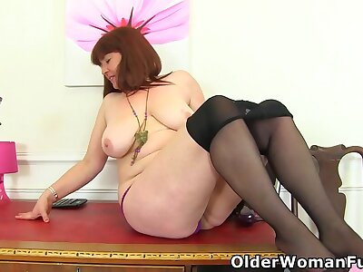 Busty office milf Janey plays with the brush soft fabricated